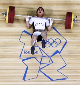 Egypts-Khalil-K-Abir-Abdelrahman-falls-after-failed-attempt-on-the-womens-75Kg-group-A-weightlifting-competition-at-the-ExCel-venue-at-the-London-2012-Olympic-Games